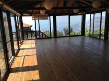 Wooden floored room with a view